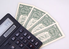 Counting dollars on calculator Royalty Free Stock Photography