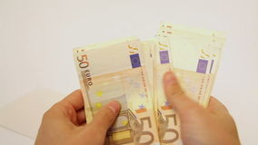 Counting euro banknotes stock footage