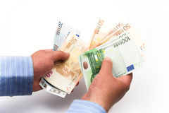Counting euro bills Stock Photos