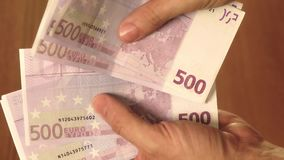 Counting five hundred euro banknotes close-up shot Stock Photo