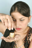 Counting gold coins Stock Images