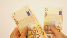 Counting handful of euro banknotes stock video footage