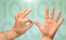 Counting hands. Hands counting with binary numbers on a green background Royalty Free Stock Photography