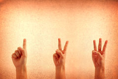 Counting Hands from one to three against a grungy royalty free stock image
