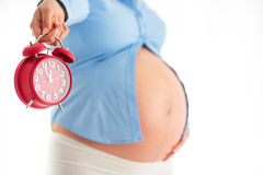 Counting hours expecting child birth. Motherhood concept. Pregna Royalty Free Stock Images