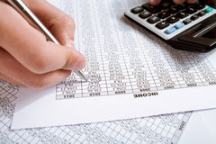 Counting income in 2010. Counting financial data on calculator closeup. analyzing income in 2010 Stock Photos