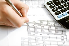 Counting income on calculator. Financial data analyzing. Counting business data on the table closeup Royalty Free Stock Photography