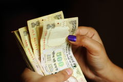 Counting Indian currency notes Royalty Free Stock Photo