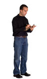 Counting Inventory. A young man wearing casual clothing, taking inventory with a clipboard Royalty Free Stock Photos