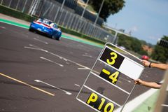 Counting laps on the track during the race of supercars royalty free stock photos