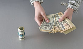 Counting large stack of cash notes Royalty Free Stock Photography
