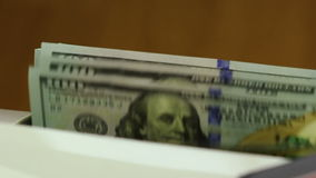 Counting Machine and US Dollars. Close Up. Machine for counting money counts 100-dollar bills USA. Close up stock video