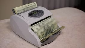 Counting Machine and US Dollars. Machine for counting money counting dollars. It banknotes hundred dollars. Video shot closeup. Video filmed on camera Canon 5d stock video