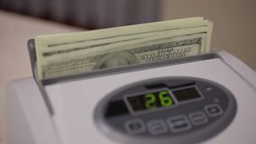 Counting Machine and US Dollars. Machine for counting money counting dollars. It banknotes hundred dollars. Video shot closeup. Video filmed on camera Canon 5d stock footage