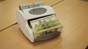 Counting Machine and US Dollars. Machine for counting money dollar counts. Video filmed on camera Canon 5d Mark 3 stock footage