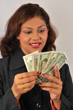 Counting money. Successful happy women counting money Stock Image