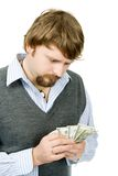 Counting money. A young man counting his money, isolated Royalty Free Stock Images