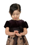 Counting Money. Beautiful little mexican girl in a pretty dress. Little spanish girl counting money in her hand Royalty Free Stock Photo