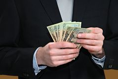 Counting Money. Close-up of man in suit with money in his hands Stock Image