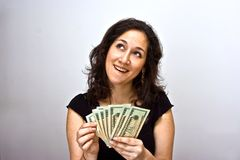 Counting money. Women counting money and thinking what she can do with it Stock Image