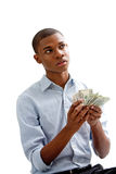 Counting money. African man holding and counting money, isolated Royalty Free Stock Photos