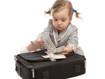 Counting money. Girl counting money on bag Stock Images