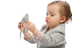 Counting money. Little girl counting money isolated Royalty Free Stock Images