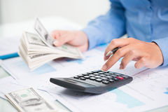 Counting money. Accountant counting money with calculator stock image