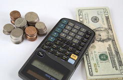 Counting money with calculator Royalty Free Stock Photography
