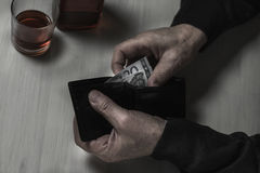 Counting money. Close-up of older alcoholic man counting money Royalty Free Stock Images