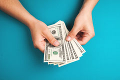 Counting money with hands. Man counting money, economy concept, allocation of money Royalty Free Stock Photography