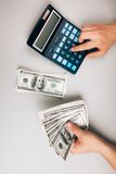 Counting money and saving finances Royalty Free Stock Image