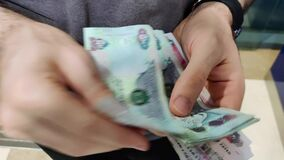 Counting money   UAE Dirhams   United Arab Emirates currency   AED - Dhs   One hundred, five hundred, two hundreds and fifty bills