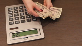 Counting money US dollars stock footage