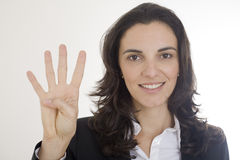 Counting number 4. Young woman counting with four fingers the number 4 Royalty Free Stock Photos