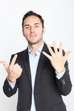 Counting number seven. Businessman counting with fingers number seven Royalty Free Stock Photography