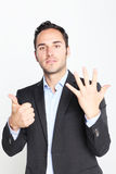 Counting number six. Businessman counting with fingers number six Royalty Free Stock Image