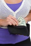 Counting Out Money. A woman counts the money in her purse before making a purchase Stock Images
