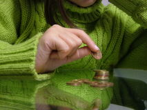 Counting Pennies Royalty Free Stock Images