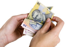 Counting Romanian money with clipping path Royalty Free Stock Image