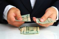 Counting some U.S. bills by a gentleman. Counting some U.S. bills Royalty Free Stock Photography