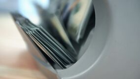 Counting US dollars banknotes. On currency counter machine. Business concept. Slow Motion Effect. Close up stock footage