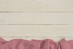 Countrified background with a red checkered tablecloth Stock Images