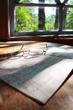 In the country. An old book on the table by the window Stock Photo