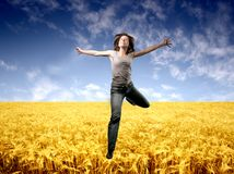 Country 166. A happy woman jump on a corn-field Royalty Free Stock Photography