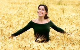 Country 49. A woman run in a corn-field Stock Photo