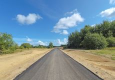 Country asphalt road. Country asphalted new road in the field royalty free stock image