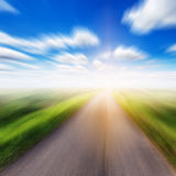 Country asphalt road in motion blur field Stock Image