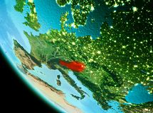 Austria in red in the evening. Country of Austria in red on planet Earth in the evening. 3D illustration. Elements of this image furnished by NASA Royalty Free Stock Images