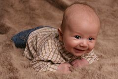 Country baby on brown Royalty Free Stock Image